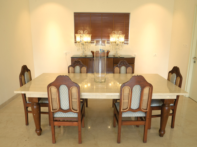 The-brown-color-chairs-warms-the-walls- the-dining-room