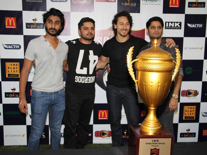 Tiger Shroff holding trophy