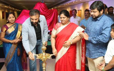 Madhan Rao lighting the lamp