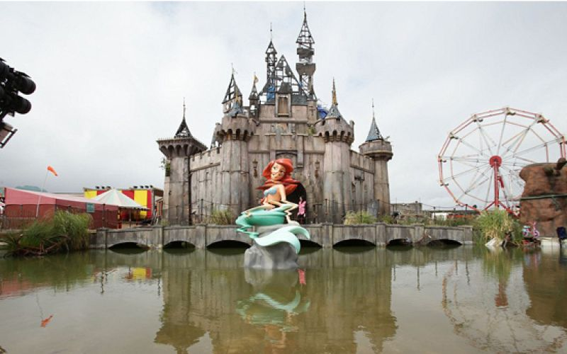 Banksy Offers Take on Disneyland With 'Dismaland'