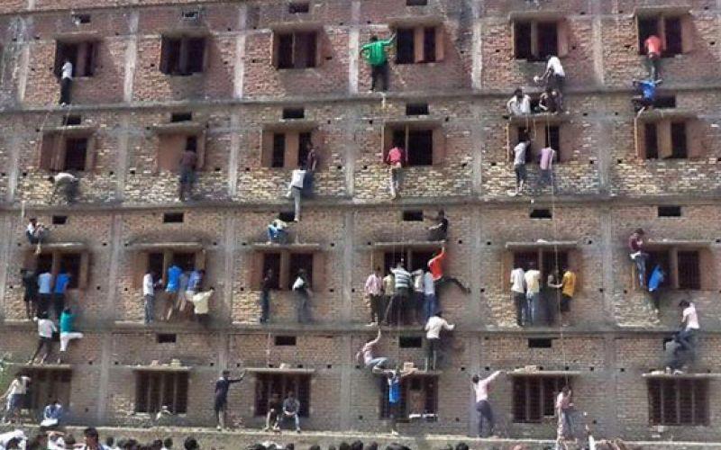 Parents Climb School Walls To Help Their Children Cheat